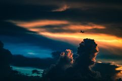 Black Airplane Flying on the Orange and Lbue Sky Royalty Free Stock Photos