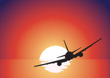 Black airplane silhouette. Over red sunset Royalty Free Stock Images