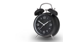 Black alarm clock with the hands at 10 and 2 Stock Image