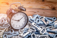 Black alarm clock with heaps of keys Stock Photography