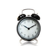 Black alarm clock isolated with cliping path. Royalty Free Stock Images