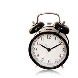 Black alarm clock isolated with cliping path. Royalty Free Stock Image