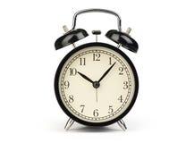 Black alarm clock. Isolated on a white Stock Photos