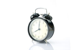 Black alarm clock isolated on white Royalty Free Stock Images
