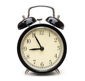 Black alarm clock isolated on white Royalty Free Stock Photos