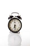Black alarm clock isolated on white Royalty Free Stock Photography