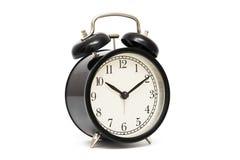 Black alarm clock isolated on white. Black vintage alarm clock isolated on white background.  royalty free stock photo