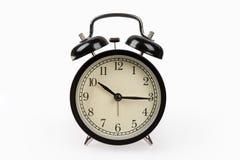 Black alarm clock isolated on white Royalty Free Stock Photo