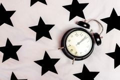 Black alarm clock marking twelve royalty free stock photo