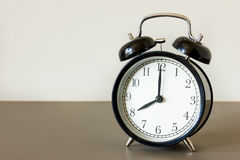 Black alarm clock. Alarm clock ring wake up 8 am in the morrnig Stock Photo