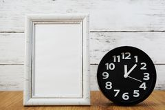Black alarm clock and space photo frame stock images