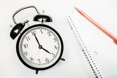 Black alarm clock tea time Royalty Free Stock Image