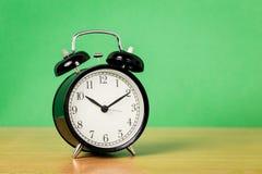 Black alarm clock Stock Images