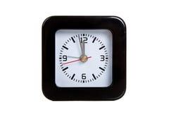 A black alarm clock on white royalty free stock image