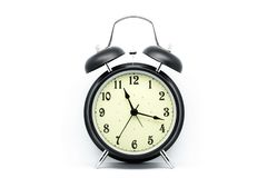 Black Alarm Clock on white background royalty free stock image