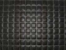Black Alligator stitched skin. Useful as texture or background. Large resolution Royalty Free Stock Photography