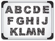 Black Alphabet on Whiteboard Stock Photo