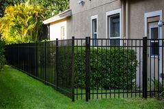 Black Aluminum Fence. 4 feet Black Aluminum Fence 3 rails around your house royalty free stock photos