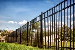 Black Aluminum Fence. 4 feet Black Aluminum Fence 3 rails around your house royalty free stock images