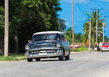 Black american classic car drive on the road trough Havana Cuba Royalty Free Stock Images