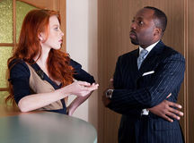 Black american man and red-haired woman Stock Photo
