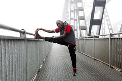 Black american runner stretch muscles Royalty Free Stock Images