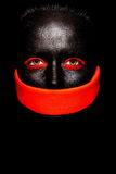 Black American woman in black mask Royalty Free Stock Image