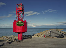 Black anchor and red buoy Stock Photos