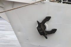 Black anchor on the white board closeup Stock Photo