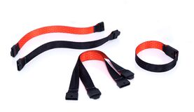 Free Black And Orange Fabric Ribbon Bracelet With Safety Breakaway Clasp. Royalty Free Stock Photo - 215418335