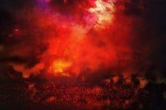 Black And Red Glitter Lights Background. Defocused