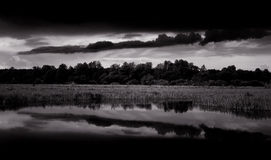 Black And White Landscape With Dark Clouds Royalty Free Stock Photography