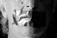 Black And White Mouth Duct Taped Shut Stock Image