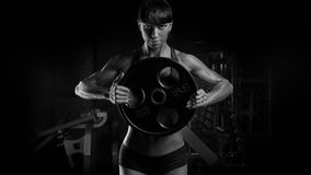 Free Black And White Photo Of Fit Power Athletic Confident Young Woman Bodybuilder Doing Exercises With Heavy Weight Barbell Plate In Stock Images - 91596734