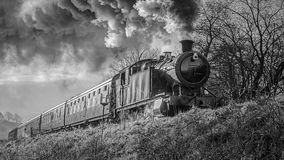 Free Black And White Steam Train From Low Angle Royalty Free Stock Images - 109540549