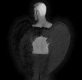 Black Angel a Dark Background Royalty Free Stock Photos