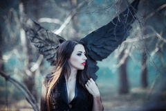 Black angel in the forest stock photos