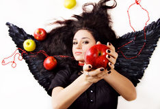 Black angel girl suggesting an apple Stock Photography
