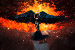 Black Angel. Pretty girl-demon. With black wings. An image for Halloween. Image of an old book of fairy tales. Fashionable toning with noise stock image