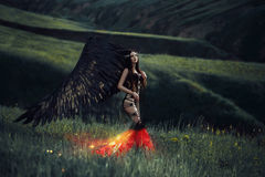 Black Angel. Pretty girl-demon Stock Photography