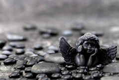 Black angel and stone Royalty Free Stock Images