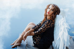 Black angel with white wings. Stock Images