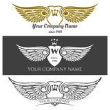 Black angel wings logo set. Vector winged labels with crowns and heraldic shields  on background Stock Photo