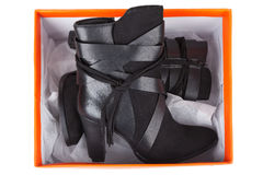Black ankle boots in a box Royalty Free Stock Photos