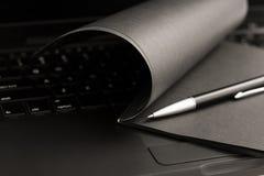 black anteckningsboken royaltyfri foto