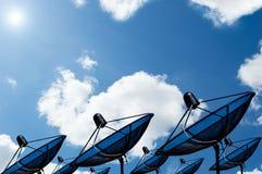 Black antenna communication satellite dish on blue sky. Background royalty free stock image