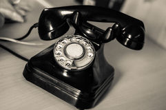The black antique phone on the table. Royalty Free Stock Photo