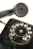 Black antique telephone Stock Images