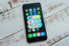 Black Apple iPhone with icons of social media. Marketing concept. royalty free stock image