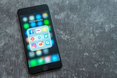 Black Apple iPhone with icons of social media. Marketing concept. stock photos